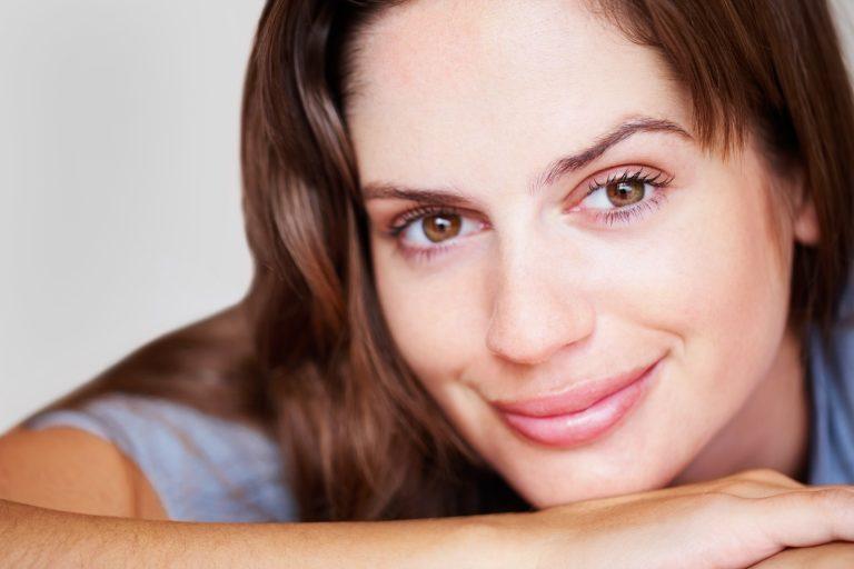 Closeup portrait of a brunette smiling