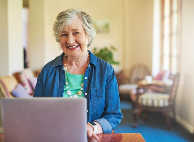 Cropped shot of a senior adult using a laptop