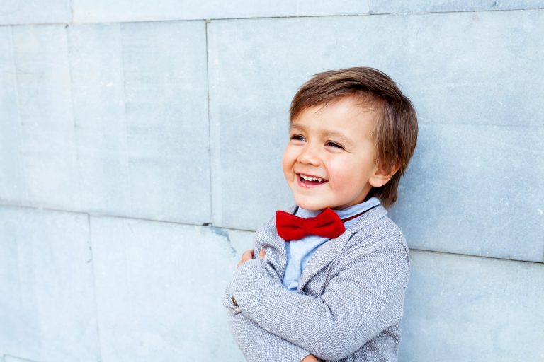 Child with bow-tie smiling